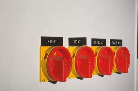 A row of industrial on off power safety switches.
