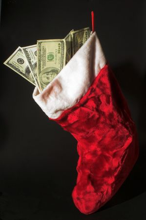 christmas debt: A red Christmas stocking loaded with cash.