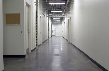 A long hallway in an industrial facility.