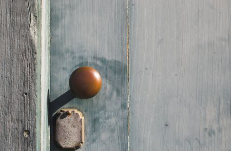 doorknob: An antique doorknob on an antique door of a historic building.