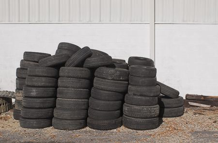 A oile of old tires outside of an auto shop. Stock Photo - 2138005