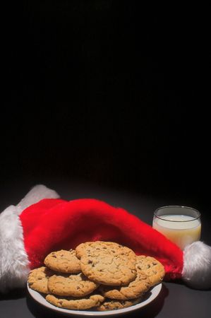 A plate of cookies and a glass of milk left out for Santa Claus photo