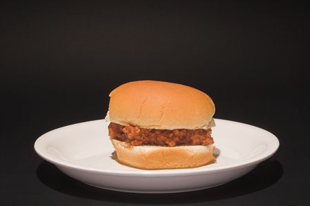 sloppy: A delicious sloppy joe sandwich on a bun.