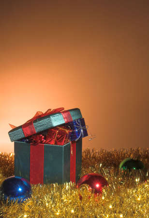A set of Christmas gifts inside a large wrapped box. Stock Photo - 2207273