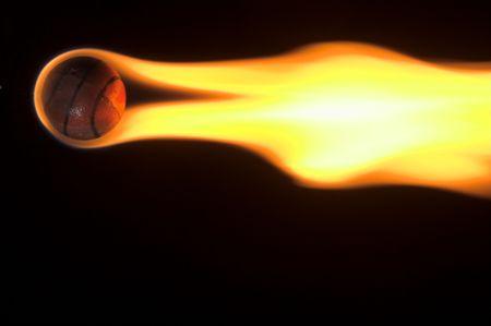 A flaming basketball rocketing across the night sky. photo