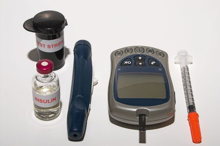 diabetes meter kit: A glucometer, test strips, syringe, insulin and a finger pricking device on a grarduated neutral background Stock Photo