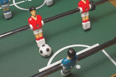 A miniature tabletop foosball arcade type game.