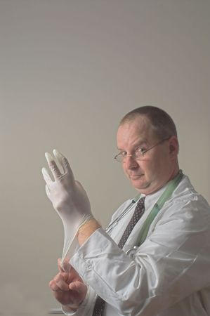 A proctologist preparing for a patient examination. Stock Photo - 2298361