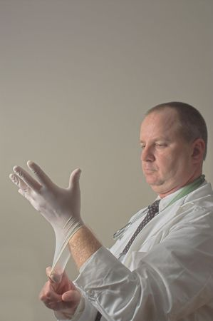 A proctologist preparing for a patient examination. Stock Photo - 2298363