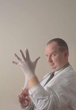 A proctologist preparing for a patient examination. Stock Photo