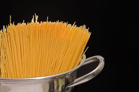 suppertime: Raw spaghetti in a stock pot ready to be cooked. Stock Photo
