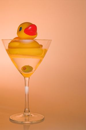 martini glass: A rubber duck in a martini glass. Stock Photo