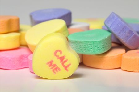 call: Conversation hearts Valentines day candy. Concept of love.