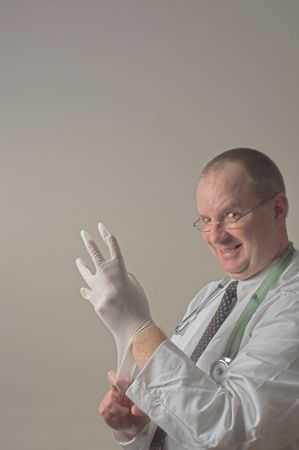 A proctologist preparing for a patient examination. Stock Photo - 2345519