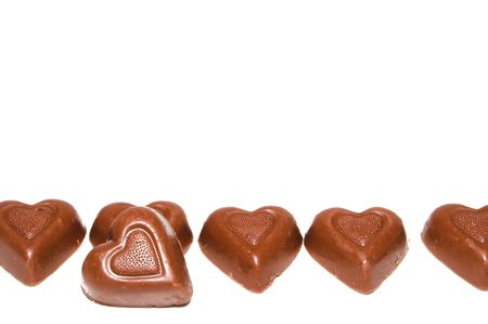 A line of delicious heart shaped milk chocolates.