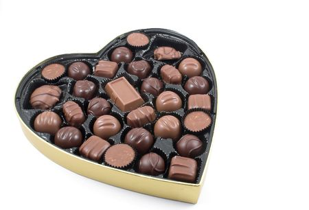 adore: A large box of chocolate Valentines candy.