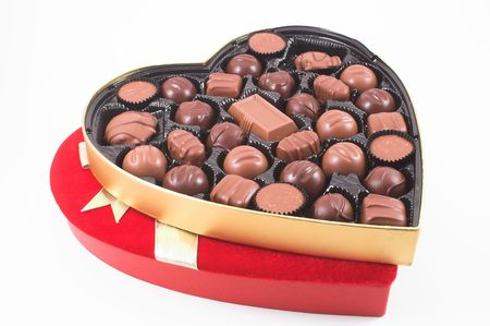 A heart shaped box of chocolate Valentines candy.