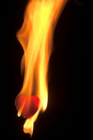 A blazing hot red heart on fire. photo