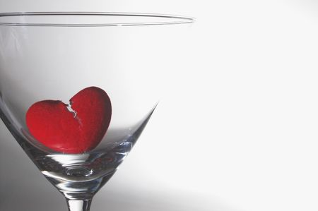 lost love: A broken heart drowning in a martini glass.