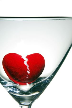 A broken heart drowning in a martini glass. photo