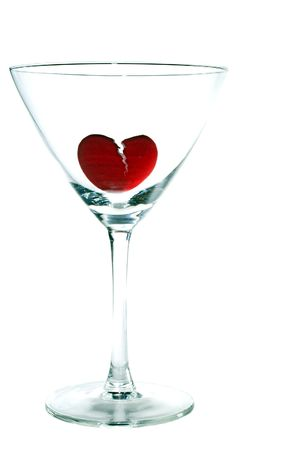 amore: A broken heart drowning in a martini glass.