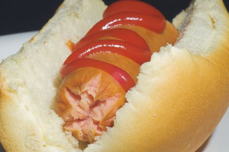 wienie: A close-up image of a delicious hotdog with ketchup.