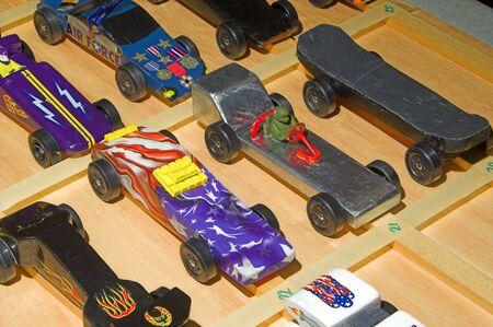racecar: A collection of Pinewood Derby cars ready to race.