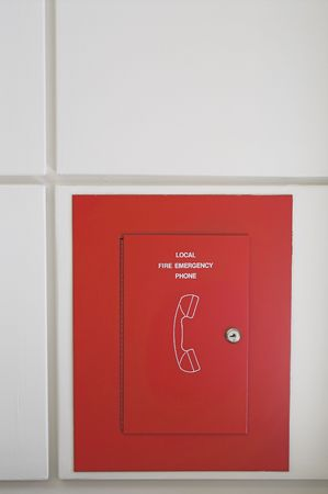 wall mounted: A fixed wall mounted fire emergeny phone. Stock Photo