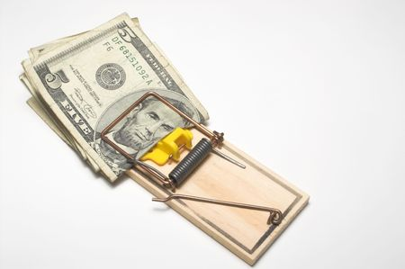 baited: Money trapped in a mousetrap. Financial concept.