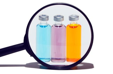 hyperglycemia: Prescription medicine vials under a magnifying glass Stock Photo