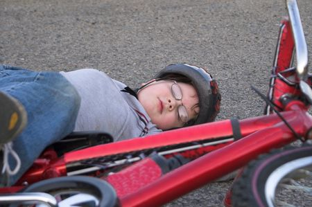 wrecks: A young boy who has crashed his bicycle. Stock Photo