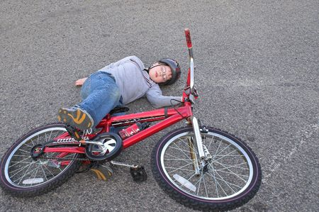 ouch: A young boy who crashed his bike.
