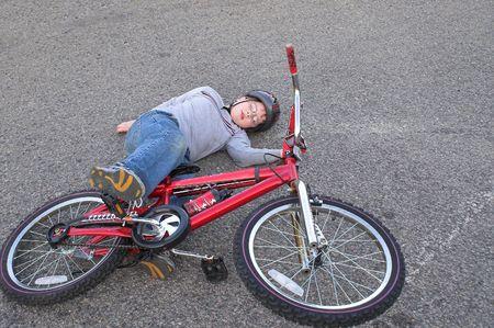 crashed: A young boy who crashed his bike.