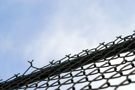 detain: A chain link fence for keeping people out or keeping people in. Stock Photo