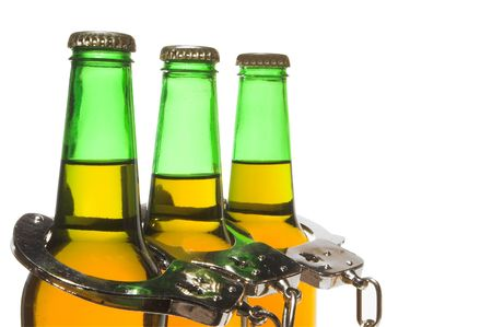 Drunk driving concept - bottled beer and handcuffs. Stock Photo - 2572161