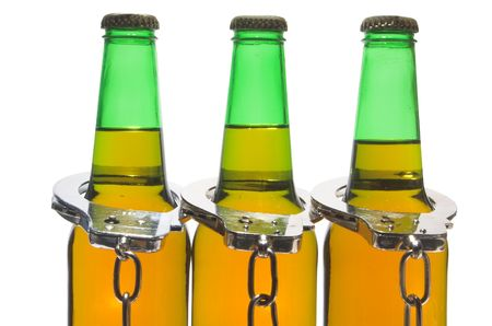 Drunk driving concept - bottled beer and handcuffs. Stock Photo - 2587230