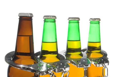 Drunk driving concept - bottled beer and handcuffs. Stock Photo - 2587231