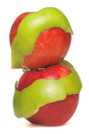 eat right: Two red apples wrapped in a Granny Smith apple peel.