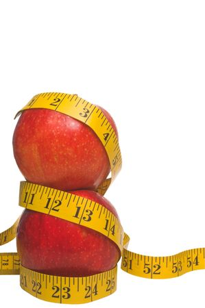 eat right: Two red apples wrapped in a tailors measuring tape. Stock Photo