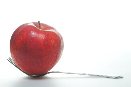 winesap apple: An fork full of apple. A serving of fruit.
