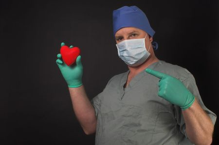 A cardiologist holding a patients heart in his hand. Stock Photo - 2656521
