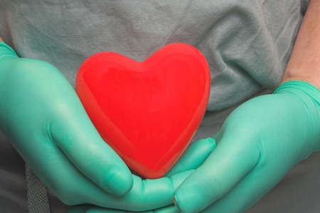 A doctor holding a patients heart in his hand Stock Photo - 2664975