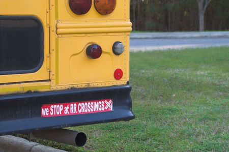 Schhol bus bumper sticker - We stop at railroad crossings. Stock Photo - 2664984