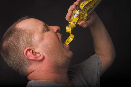 A man enjoying a beverage. Diet drink concept. Archivio Fotografico