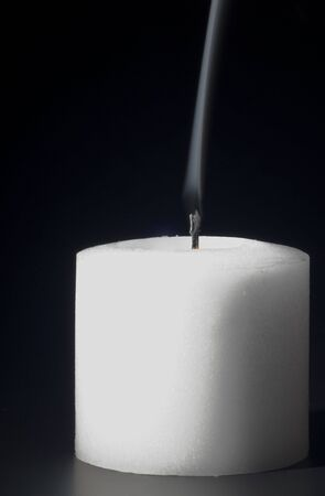 burned out: Smoke rising from a freshly snuffed candle.