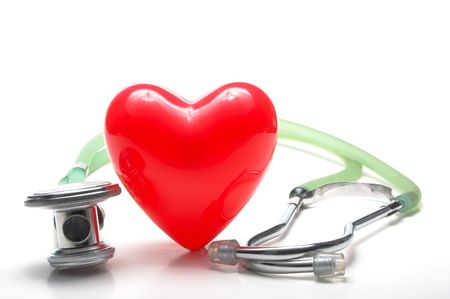 A red heart shape and a medical stethoscope. Stock Photo - 2751455