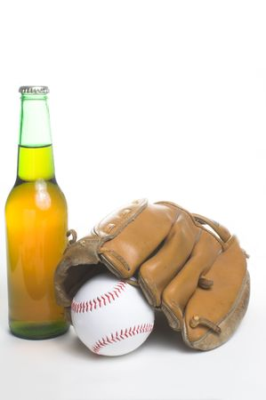 near beer: A baseball, mitt and a bottle of beer.