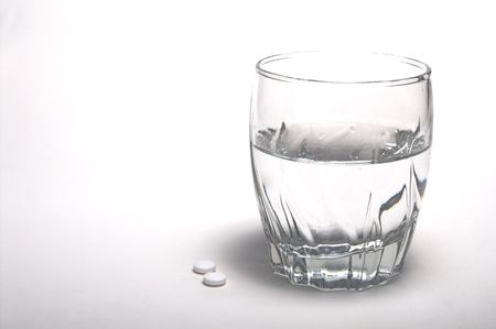 painkiller: Two aspirin and a glass of water. Stock Photo
