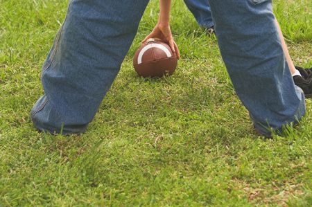linemen: A football being hiked during a game.