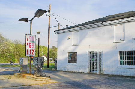Old gas station with old gas station prices. Stock Photo - 2909504